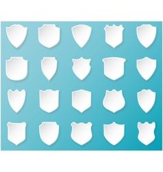 Shiny white shields on blue background vector image