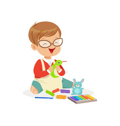 cute little boy making figures from a plasticine vector image