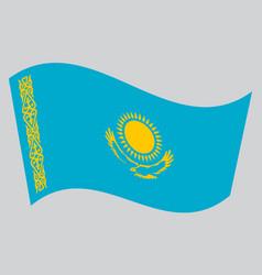flag of kazakhstan waving on gray background vector image