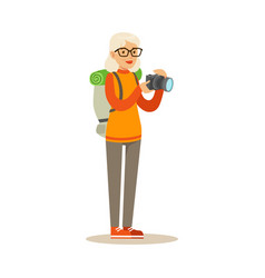 active tourist senior woman with backpack taking vector image vector image