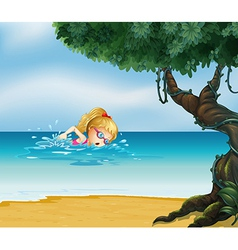 A young lady swimming at the beach vector image