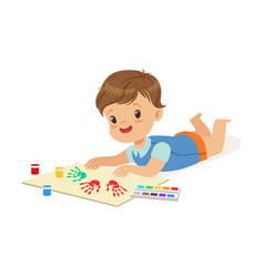 happy smiling little boy lying on his stomach and vector image