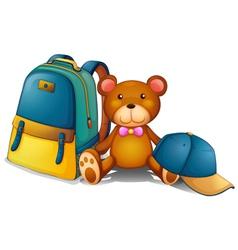 A backpack a bear and a baseball cap vector image vector image