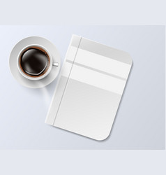 A cup coffee and saucer with notebook top vector