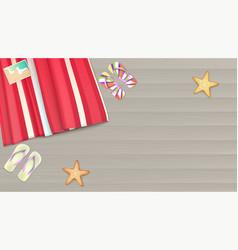 top view towel beach mat lies on a light wooden vector image
