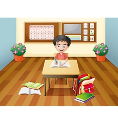 A boy writing at the table vector image vector image