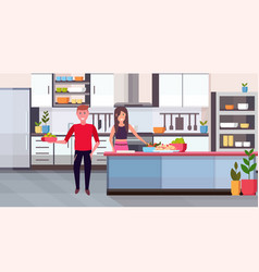 Couple making dinner happy man woman cooking vector