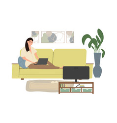 cute young woman sitting on couch with laptop vector image
