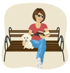 woman reading book sitting on a bench vector image
