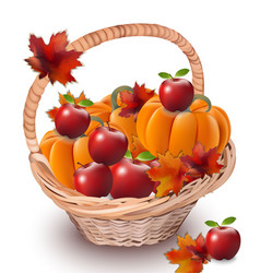 Pumpkins and apples in a basket autumn season vector