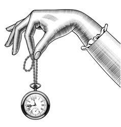 Womans hand with a retro pocket watch vector