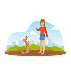 girl walking and playing ball with dog in park in vector image