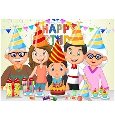 Happy girl blowing birthday candles with her famil vector image