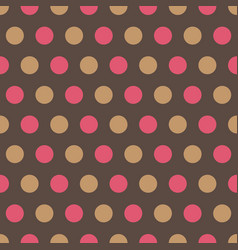 Pink and tan polka dots on gray background vector