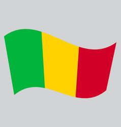 Flag of mali waving on gray background vector