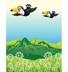 Two birds flying along the mountains vector