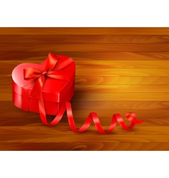 Holiday background with gift red box and red vector image