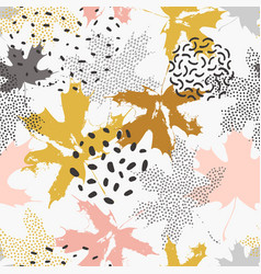 Abstract maple leaves seamless pattern in gold vector