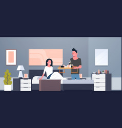 man bringing breakfast for his woman in bed happy vector image