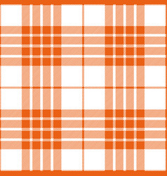 Orange tartan plaid seamless pattern vector