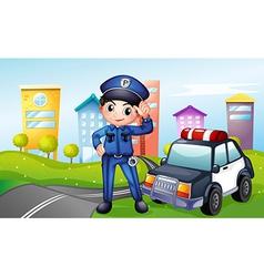 A policeman with a police car along the street vector image vector image