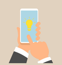 hand holding smartphone with light bulb on display vector image