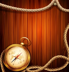 vintage background with a compass and marine rope vector image