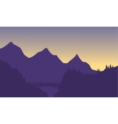 Silhouette of mountain and bridge vector image