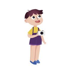 Curious cartoon little boy standing with camera vector