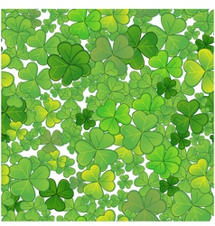 Seamless background with clovers EPS10 vector image