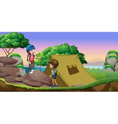 Two kids camping out by the lake vector image
