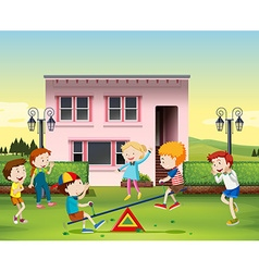 Children playing seesaw at the park vector image