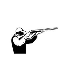 Bird hunter or duck shooter aiming a shotgun vector