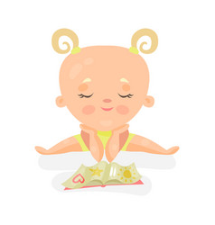adorable baby girl sitting and playing with book vector image