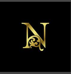 Gold luxury letter n ornament logo alphabet vector