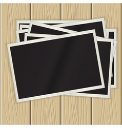 photos on a wooden surface vector image vector image