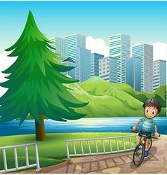 A boy biking across tall buildings near the vector