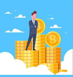 successful businessman standing at bitcoins stack vector image