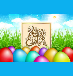 Colorful eggs in a field of grass with blue sky vector