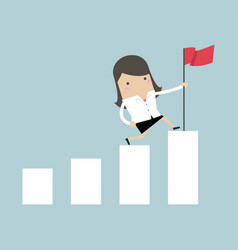businesswoman holding a flag on top the graph vector image