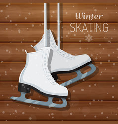 white ice skates on wooden vector image vector image