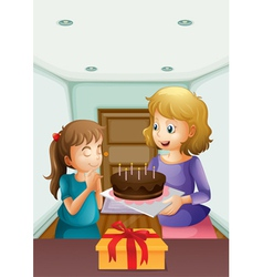 A girl wishing before blowing her birthday cake vector image vector image