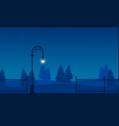 silhouette of garden with fence and street lamp vector image