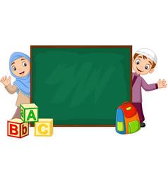 cartoon muslim kids with chalkboard vector image