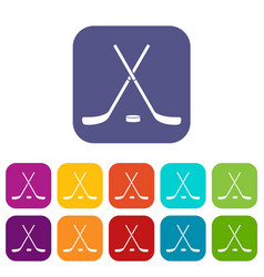 Crossed hockey sticks and puck icons set vector