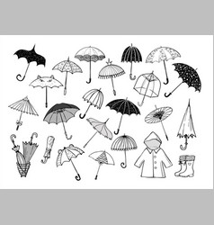 Set of doodle sketch umbrellas on white background vector
