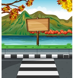 Wooden sign along the road vector