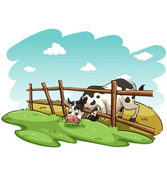 A cow at the field vector image