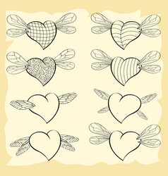 Contoured valentine hearts with wings of insects vector