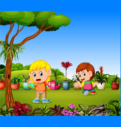 Little girl watering plants and a boy planting vector